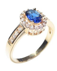 High Class Gold Filled Ring. Set With A Blue Sapphire Created Diamond Surrounded By Simulated Diamond Brilliant Rounds